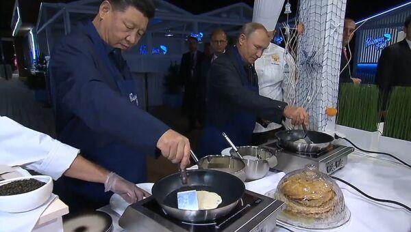 Мы же в России - лидеры КНР и России приготовили блины и пригубили водку
