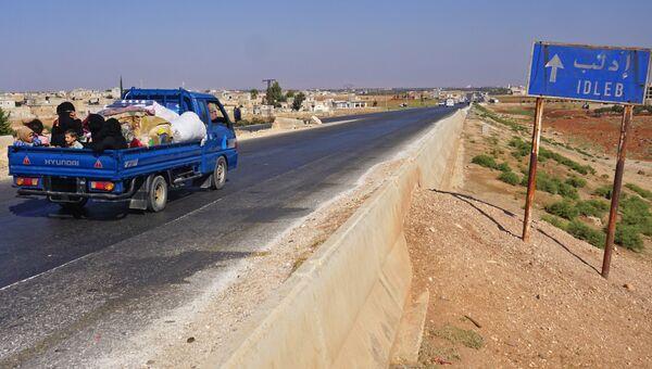 Люди в автомобиле в провинции Идлиб