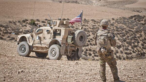 Американские военнослужащие в районе населенного пункта Манбидж, Сирия. 18 июля 2018