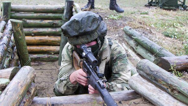 Военнослужащий разведывательного соединения снайпер Артем Трусов