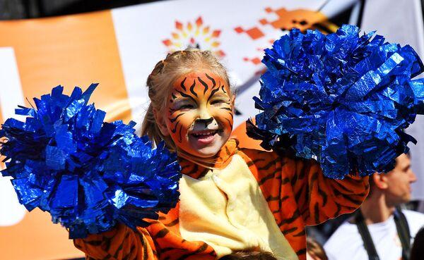 Юная участница праздничных мероприятий, посвященных Дню тигра, во Владивостоке