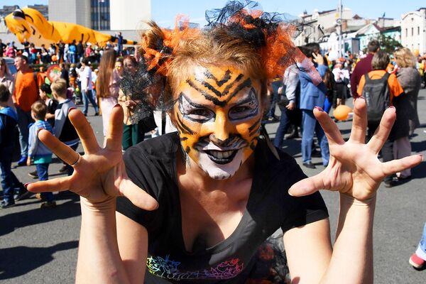 Участница праздничных мероприятий, посвященных Дню тигра, во Владивостоке