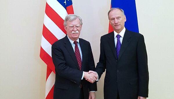 Секретарь Совета безопасности РФ Николай Патрушев и советник президента США по вопросам национальной безопасности Джон Болтон во время встречи в Москве