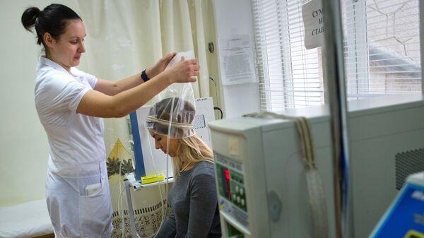 Девушка на сеансе озонотерапии в санатории Ай-Петри