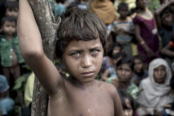 Снимок Battle Victim фотографа из Бангладеш K M Asad, победивший в категории Лучшая фотография года в конкурсе Siena International Photo Awards 2018