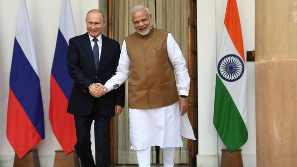 Президент РФ Владимир Путин и премьер-министр Республики Индии Нарендра Моди во время встречи