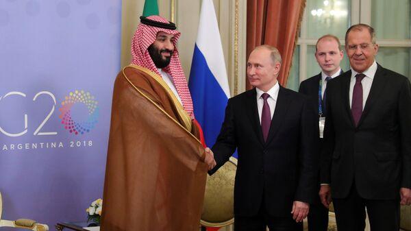 Президент РФ Владимир Путин и наследный принц Саудовской Аравии Мухаммед бен Сальман аль Сауд время встречи на полях саммита G20 в Буэнос-Айресе