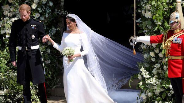 Британский принц Гарри и его жена Меган после свадебной церемонии в Виндзоре
