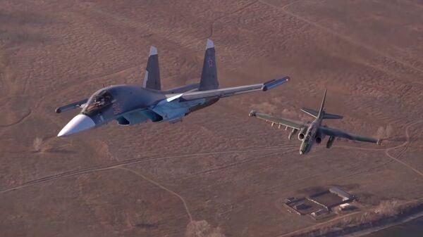 Уникальные кадры воздушных тренировок летчиков Су-25 и Су-34