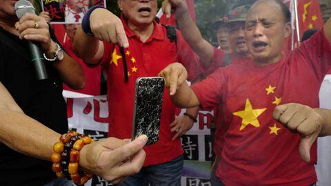 Митинг против торговой политики президента США Дональда Трампа в Гонконге