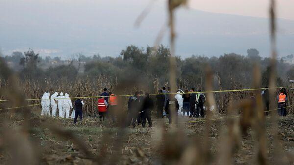 Место падения вертолета в Мексике, на борту которого находились губернатор штата Пуэбла