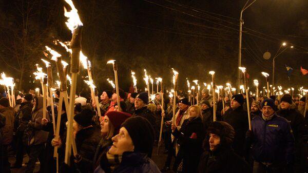 Участники факельного шествия националистов, приуроченного к годовщине со дня рождения Степана Бандеры в Киеве