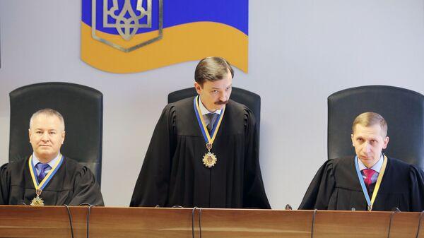 Судьи в Оболонском районном суде города Киева, где проходит судебное заседание, на котором зачитывается приговор экс-президенту Украины Виктору Януковичу. 24 января 2019