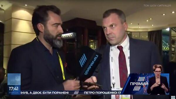 Скриншот видео, где муж журналистки Ольги Скабеевой отказывается давать комментарии