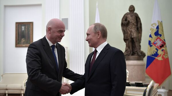 Президент РФ Владимир Путин и президент ФИФА Джанни Инфантино во время встречи