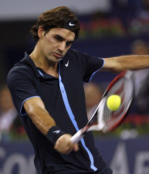 Роджер Федерер в матче против Энди Мюррея на итоговом турнире ATP