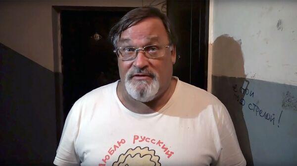 Стоп-кадр видео комментария журналиста Владимира Скачко по поводу преследования со стороны СБУ