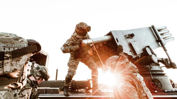 Хорватские военные, входящие в состав одной из четырех боевых групп расширенного присутствия НАТО в Балтийском регионе, во время учений на территории Польши
