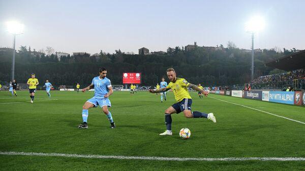 Игровой момент матча Сан-Марино - Шотландия
