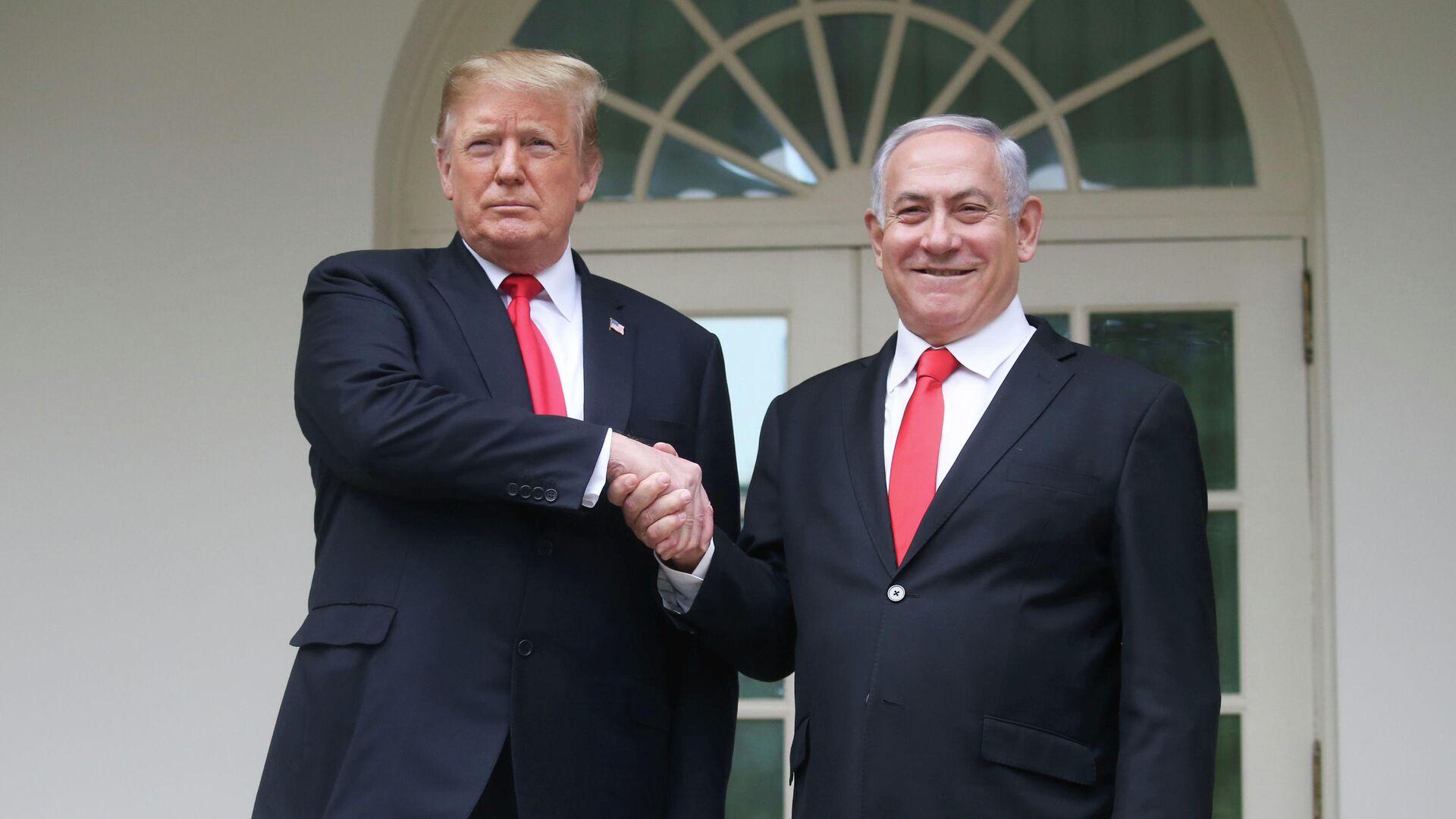 Президент США Дональд Трамп и премьер-министр Израиля Биньямин Нетаньяху в Белом доме в Вашингтоне. 25 марта 2019  - РИА Новости, 1920, 12.01.2021