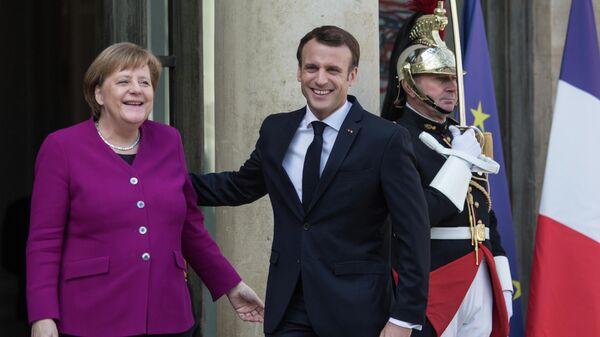 Федеральный канцлер Германии Ангела Меркель и президент Франции Эммануэль Макрон. Архивное фото