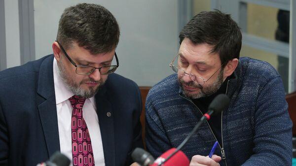 Руководитель портала РИА Новости Украина Кирилл Вышинский и адвокат Андрей Доманский
