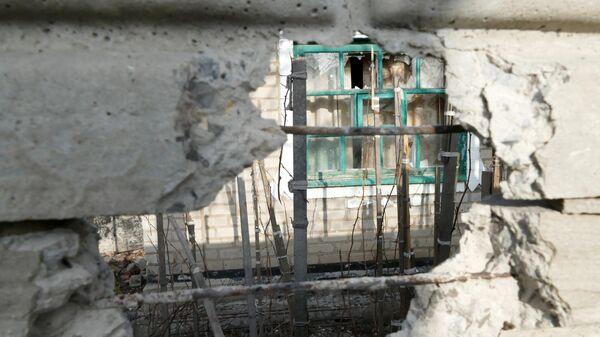 Последствия обстрелов населенных пунктов в Донецкой области
