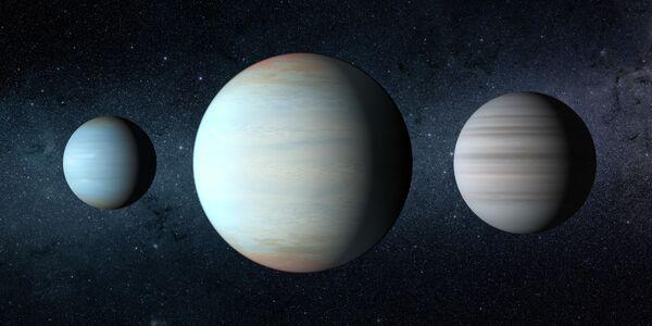 Третья планета (в центре), открытая в уникальной звездной системе Kepler-47
