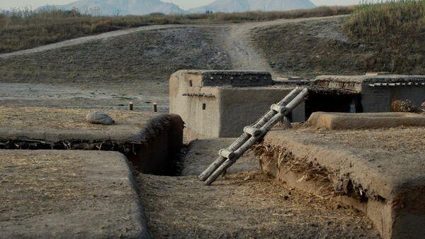 Реконструкция древних домов, чьи фундаменты были найдены в Ашыклы Хеюке