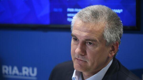 Глава Республики Крым Сергей Аксёнов дает интервью на стенде МИА Россия сегодня в рамках Ялтинского международного экономического форума. 19 апреля 2019