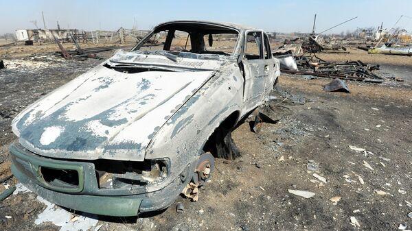 Сгоревший в результате пожара автомобиль в селе Усть-Ималка Ононского района Забайкальского края