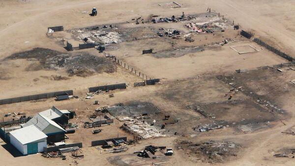 Участки домов в поселке Усть-Ималка Ононского района Забайкальского края, разрушенных после степных пожаров 19 апреля 2019