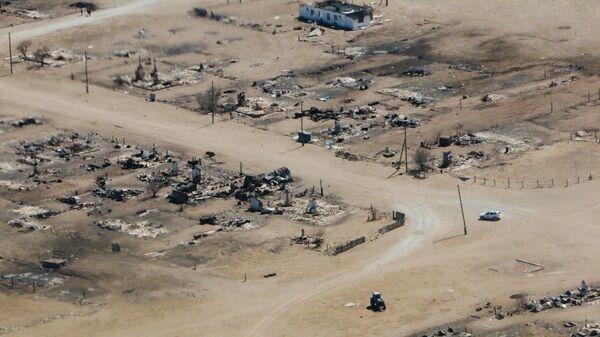 Участки домов в поселке Усть-Ималка Ононского района Забайкальского края, разрушенных после степных пожаров. 19 апреля 2019