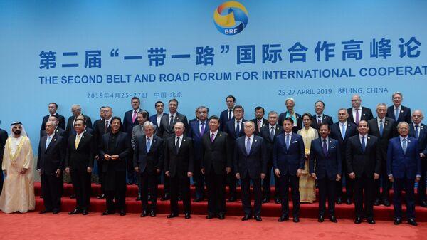 Президент РФ Владимир Путин на церемонии совместного фотографирования глав делегаций стран-участников форума международного сотрудничества Один пояс - один путь в Пекине. 27 апреля 2019
