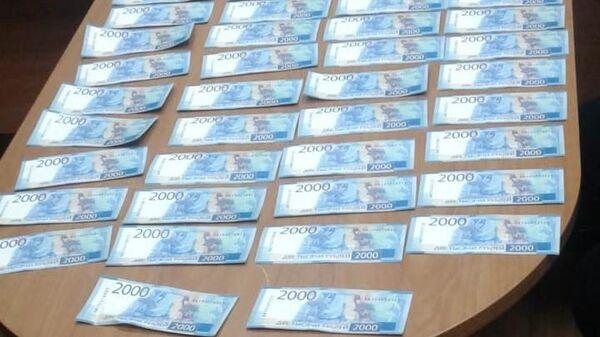 Поддельные купюры, изъятые полицейскими Череповца у фальшивомонетчиков