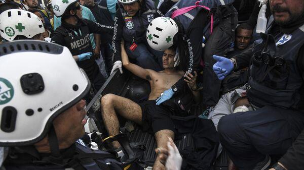 Раненый в столкновении с Национальной гвардией Венесуэлы в Альтамире, районе Каракаса