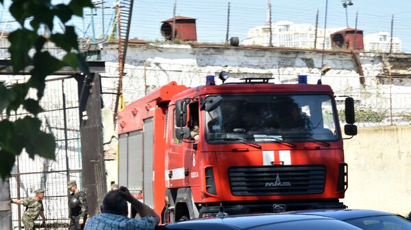 Машина пожарной службы на территории Южной исправительной колонии общего режима №51 в Одессе, где произошло массовое неповиновение заключенных.