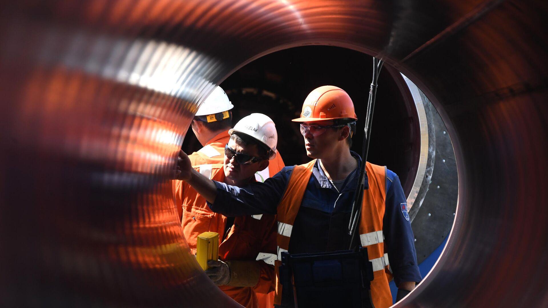 Рабочие на участке строительства газопровода Северный поток-2 в Ленинградской области - РИА Новости, 1920, 08.06.2021