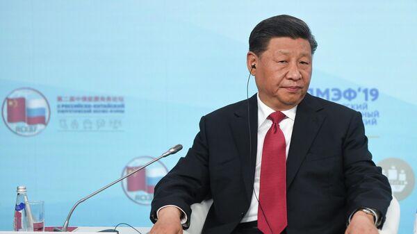 Председатель Китайской Народной Республики (КНР) Си Цзиньпинь во время встречи с участниками Российско-китайского энергетического форума на полях Петербургского международного экономического форума 2019