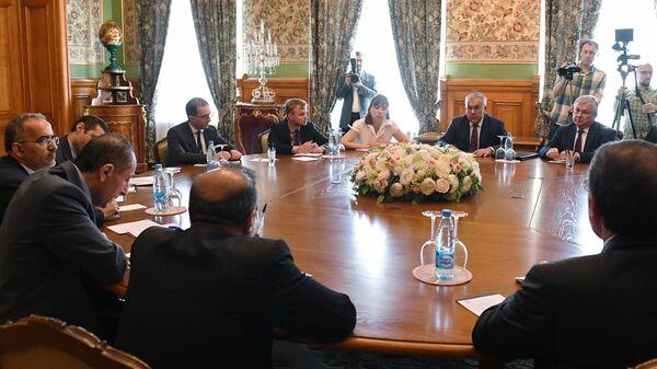 Заместитель министра иностранных дел РФ Сергей Вершинин во время встречи со старшим помощником министра иностранных дел по политическим вопросам Ирана Али Асгаром Хаджи в Москве. 10 июня 2019