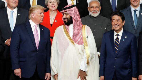 Президент США разговаривает с наследным принцем Саудовской Аравии на саммите G20 в Осаке. 28 июня 2019