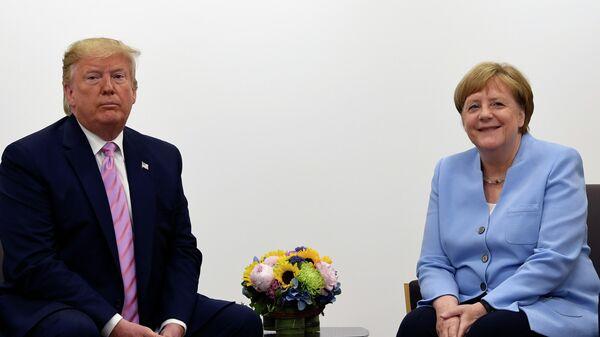 Канцлер Германии Ангела Меркель с президентом США Дональдом Трампом на саммите G20. 28.06.2019
