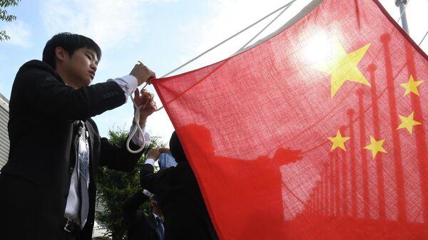 Вывешивание флага Китая