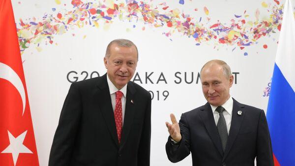 Рабочий визит президента РФ В. Путина в Японию для участия в саммите Группы двадцати. День второй