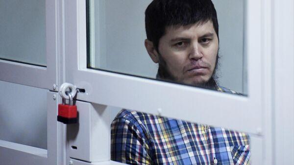 Хазратхон Додохонов во время оглашения приговора участнику банды GTA в Московском областном суде. 2 июля 2019