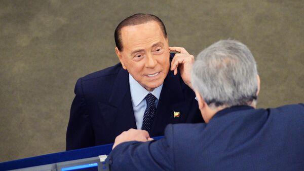 Депутат от партии Вперед, Италия Сильвио Берлускони на первой сессии нового Европейского парламента в Страсбурге