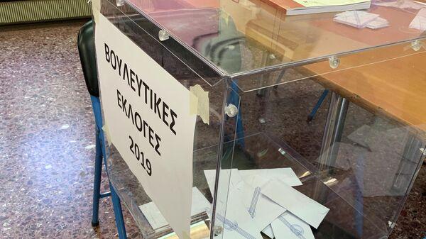 Урна для голосования на досрочных парламентских выборах в Греции. 7 июля 2019