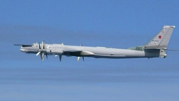 Снимок российского бомбардировщика Ту-95, опубликованный Министерством обороны Японии. 23 июля 2019
