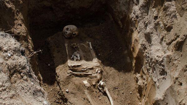 Жертва латвийских карателей, погребенная в районе деревни Жестяная Горка