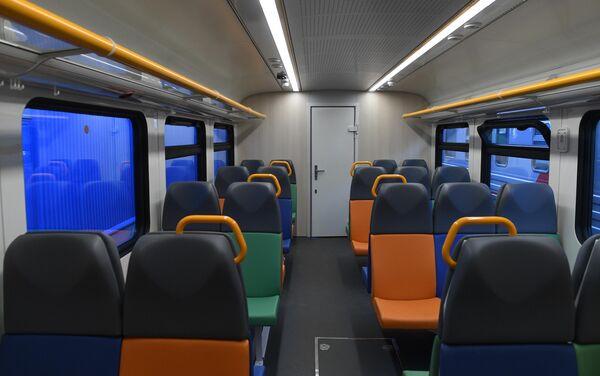 Вагон рельсового автобуса РА-3 на международном железнодорожном салоне PRO//Движение.Экспо